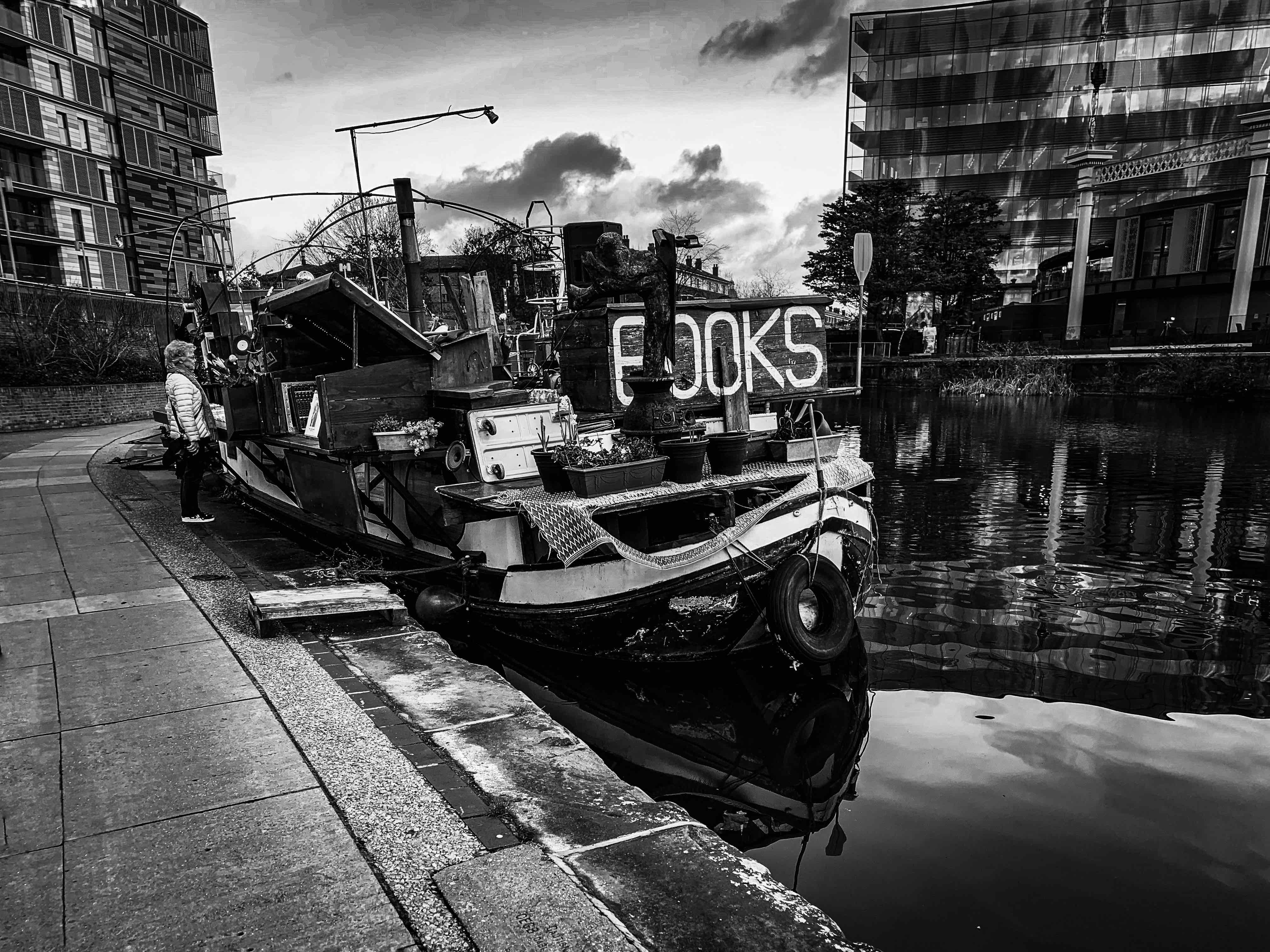 'Words On The Water' book barge moored down stream east from the Coal Drops Yard. The boat is an old barge that has been build out in all directions selling books and records. It's kitschy, but the best kind.